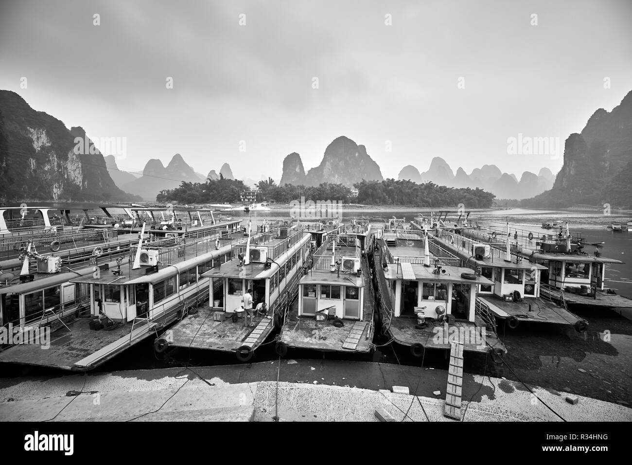 Xingping, Guangxi, China - September 18, 2017: Boats moored at the Lijiang River bank. - Stock Image