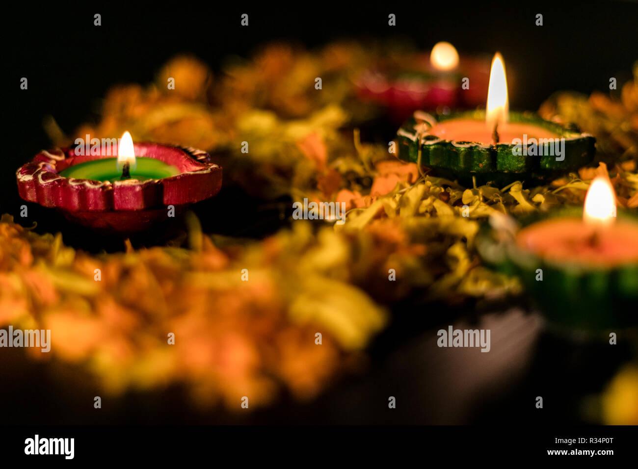 Diya placed on swastik for celebrating diwali and dhanteras in Asia Stock Photo