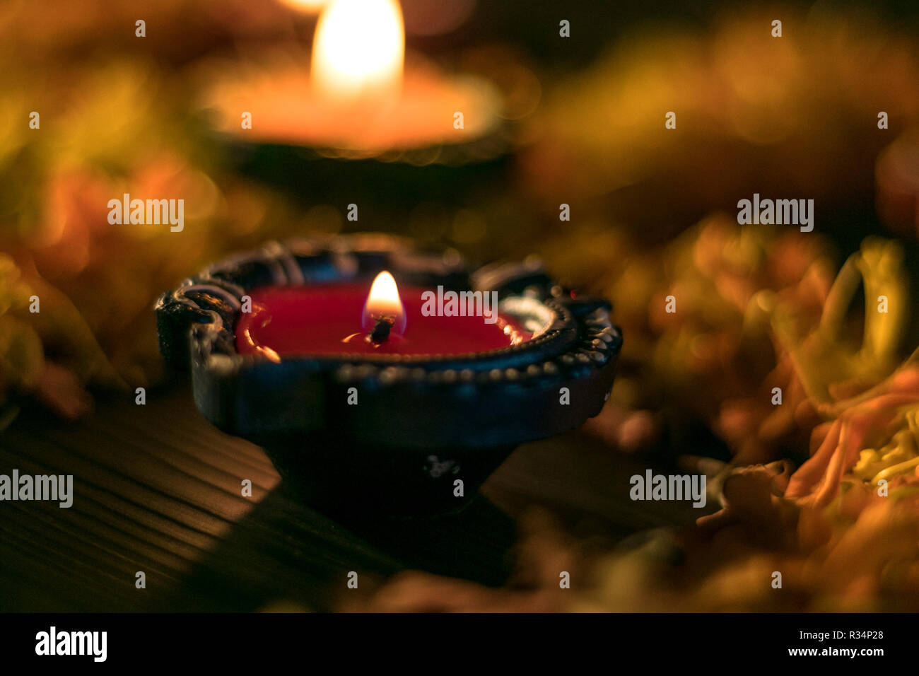 A close-up view of lit diya for celebrating diwali and dhanteras in Asia Stock Photo