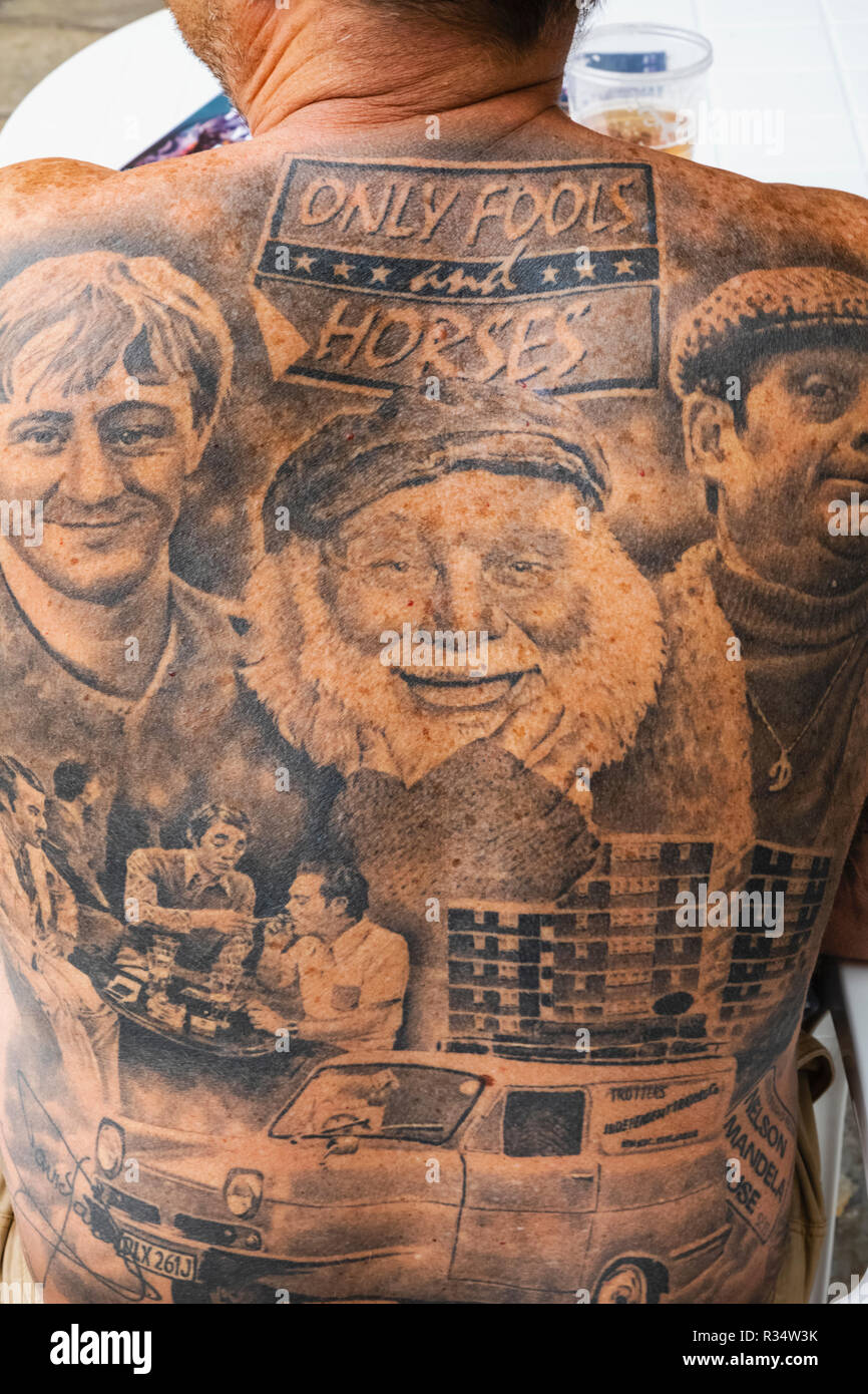England London Wapping Tobacco Dock London Tattoo Convention Tattooed Male Showing Characters From The English Tv Show Only Fools And Horses Stock Photo Alamy