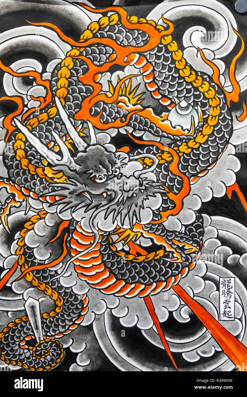 England, London, Wapping, Tobacco Dock, London Tattoo Convention, Asian Tattooist's Artwork depicting a Dragon Stock Photo