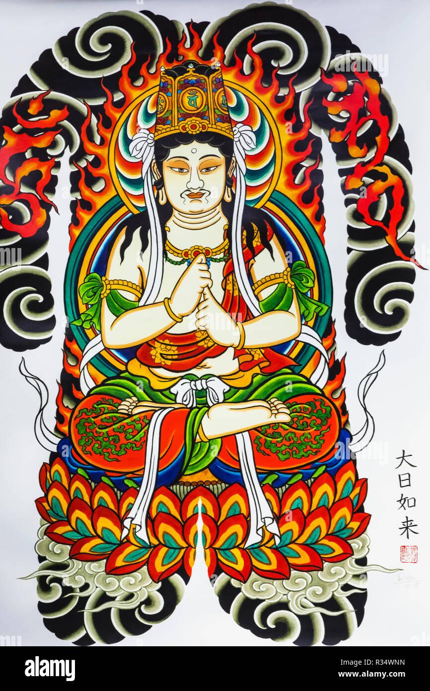 England, London, Wapping, Tobacco Dock, London Tattoo Convention, Asian Tattooist's Artwork depicting Figure Meditating - Stock Image