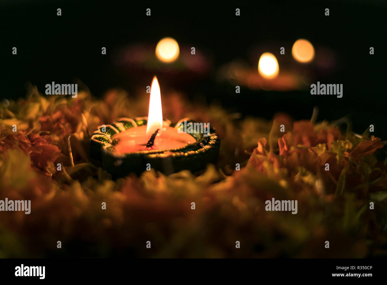 Lit Diyas arranged on a table to celebrate diwali and dhanteras in Asia Stock Photo