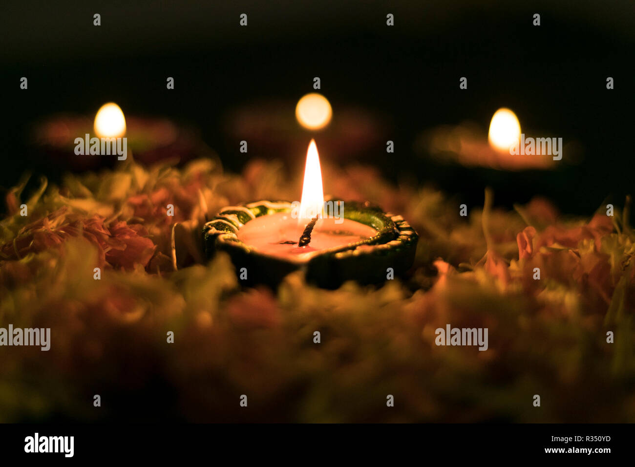 Diya placed on swastik for celebrating diwali and dhanteras in Asia Stock Photo