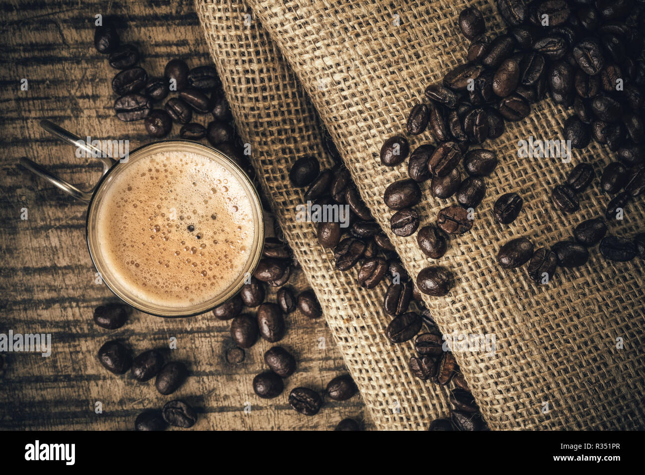Espresso coffee on an old wooden table - Stock Image