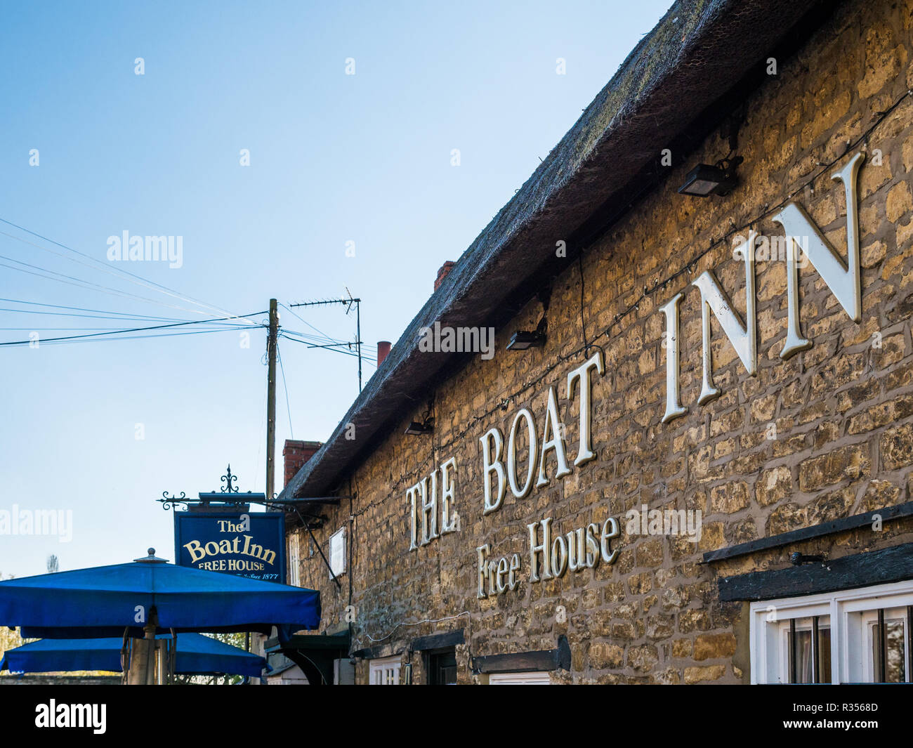 Stoke Bruerne UK October 31 2018: boat inn pub and restaurant next to canal river in village in northamptonshire, england. - Stock Image