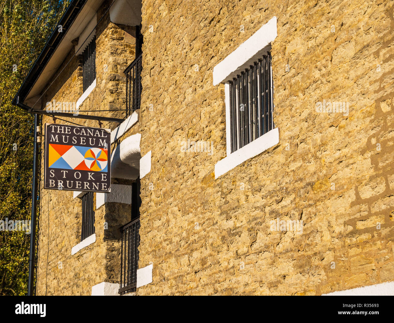 Stoke Bruerne UK October 31 2018: canal museum logo next to canal river in village in northamptonshire, england. - Stock Image