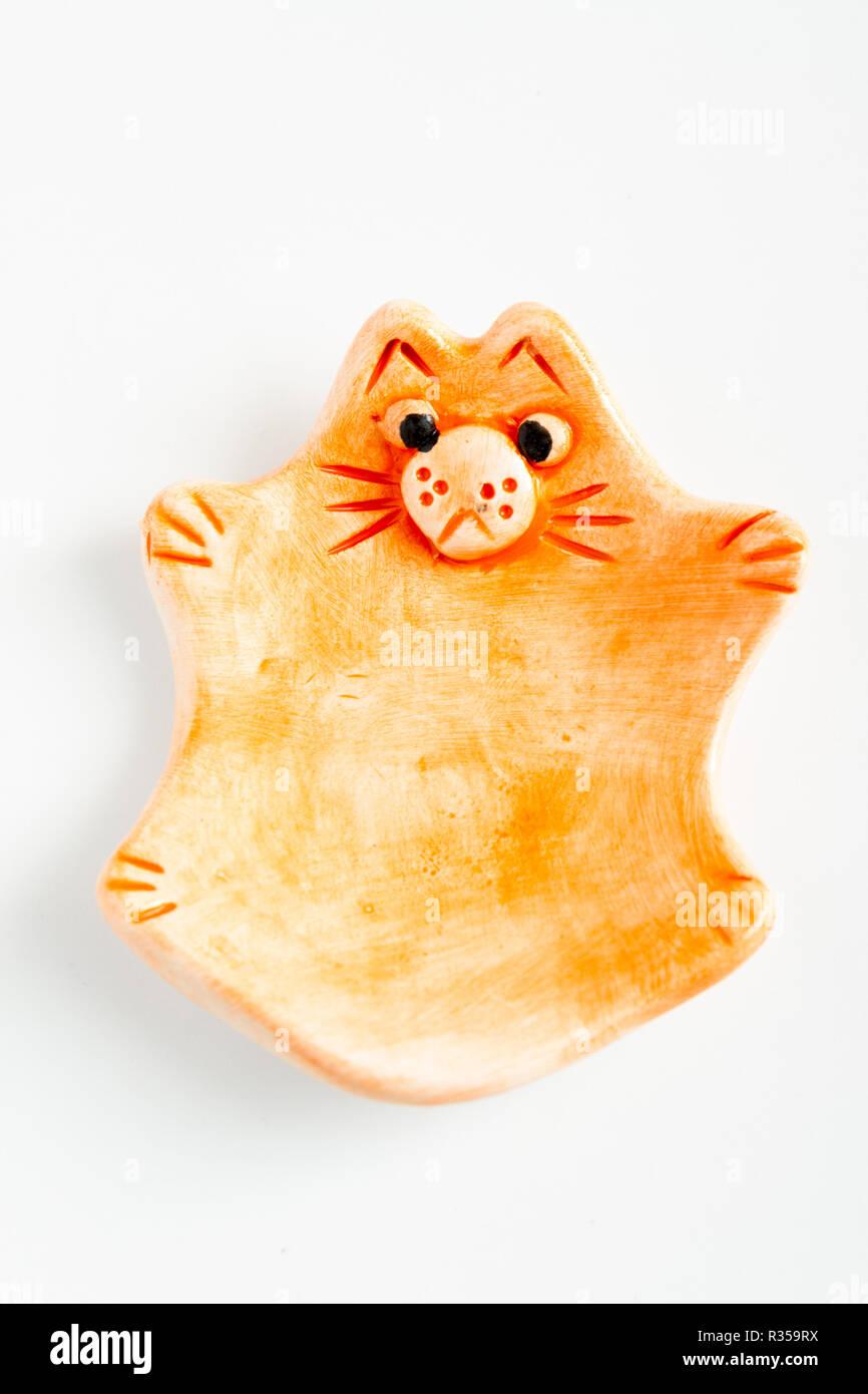 ESKISEHIR, TURKEY - DEC 1, 2016: Cute colorful ceramic cat shape ashtray on white background - Stock Image