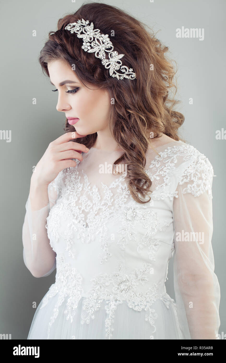 Romantic bride in white bridal dress. Wedding hair and makeup ...
