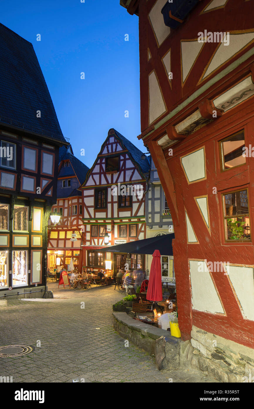 Half-timbered buildings in Fischmarkt at dusk, Limburg, Hesse, Germany - Stock Image