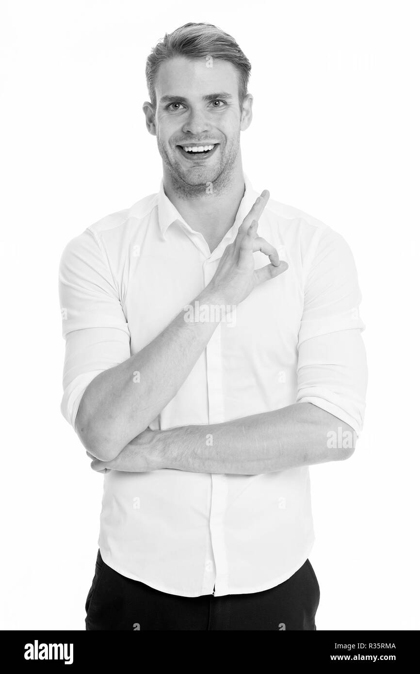 No problems. Man smiling face posing confidently ready to help white background. Guy with bristle glad to help you in shop. Man shop consultant looks confident and hospitable. Guy shows ok gesture. - Stock Image