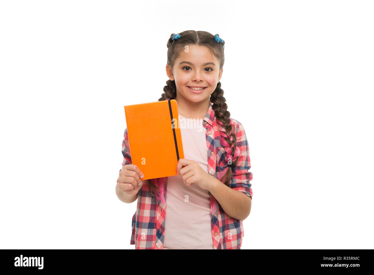 Child cute girl hold notepad or diary isolated on white background. Diary writing for children. Childhood memories. Diary for girls concept. Note secrets down in your cute girly diary journal. - Stock Image