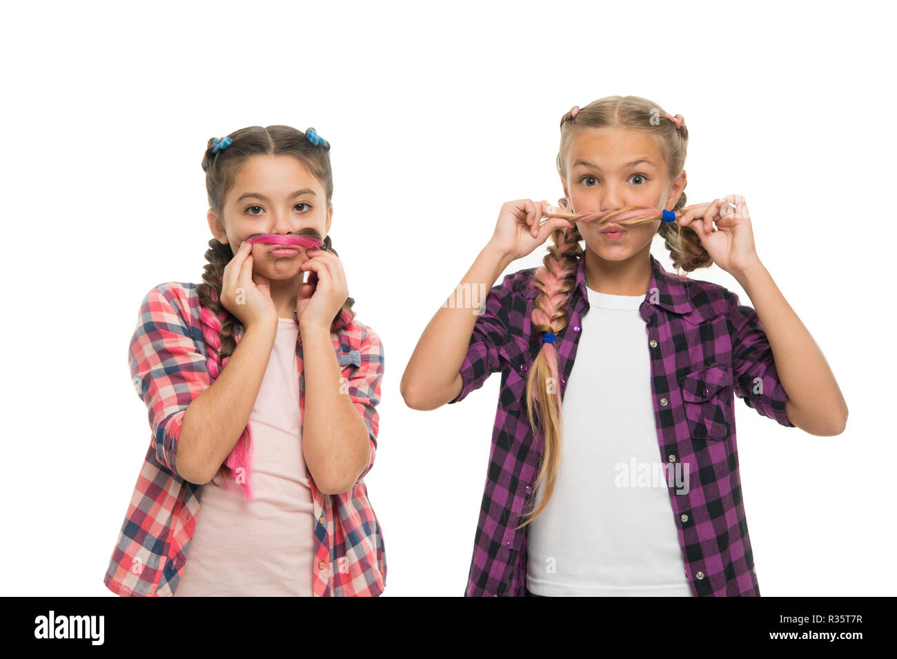 Girls friends wear similar outfits have same hairstyle braids white background. Sisters family look. Kanekalon jumbo braids hairstyle. Long hair hairstyle. Keep hairstyle braided for healthier hair. - Stock Image