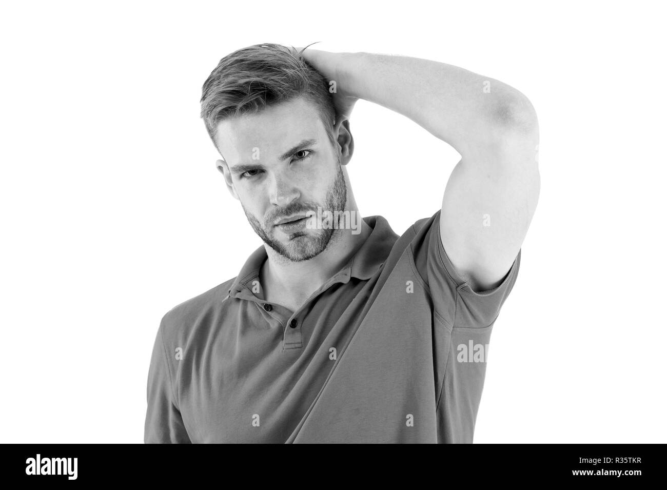 Effective antiperspirant. Man confident in his antiperspirant. Sportsman after training pleased with antiperspirant. Guy checks dry armpit satisfied with clean clothes. Prevent, reduce perspiration. - Stock Image