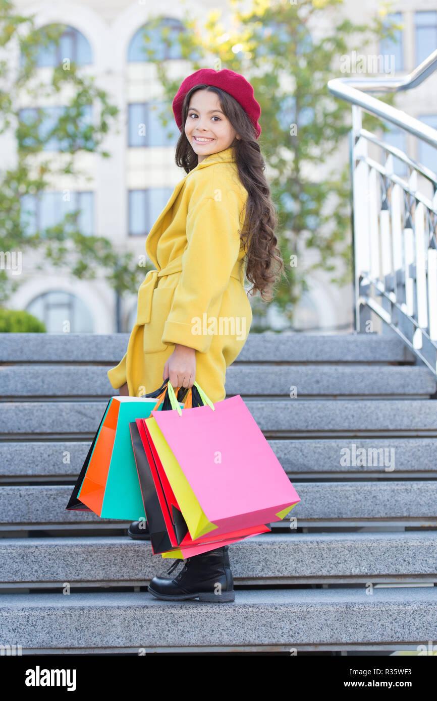 77f26da236 Little child shopping fall sale season. Child adorable stylish hold bunch