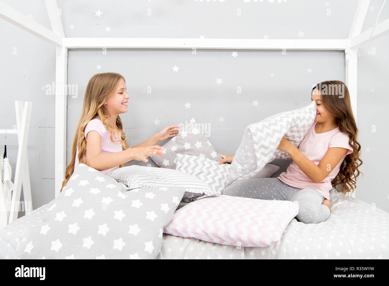 3c9a2b5e95 Best girls sleepover party ideas. Girls happy best friends in pajamas with pillows  sleepover party. Soulmates girls having fun sleepover party.