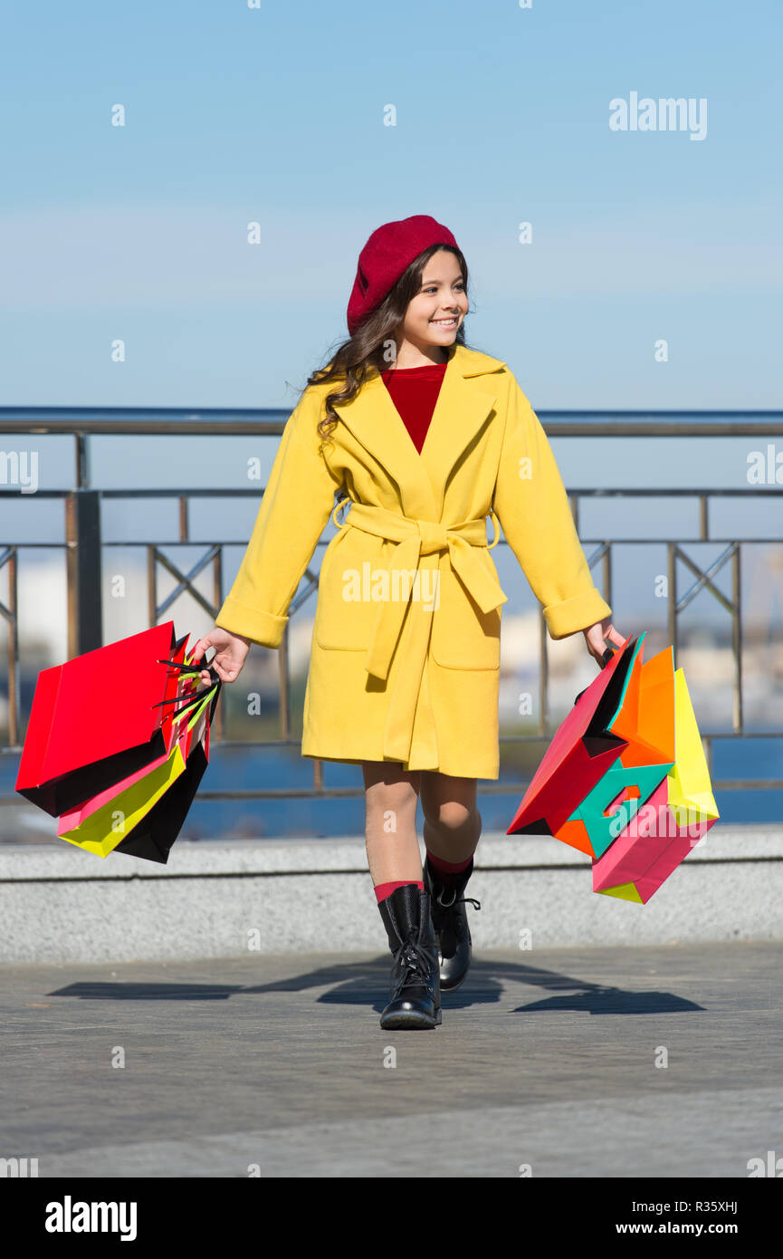 b169b08b0e Little child shopping fall sale season. Child adorable stylish hold bunch  shopping bags. Girl