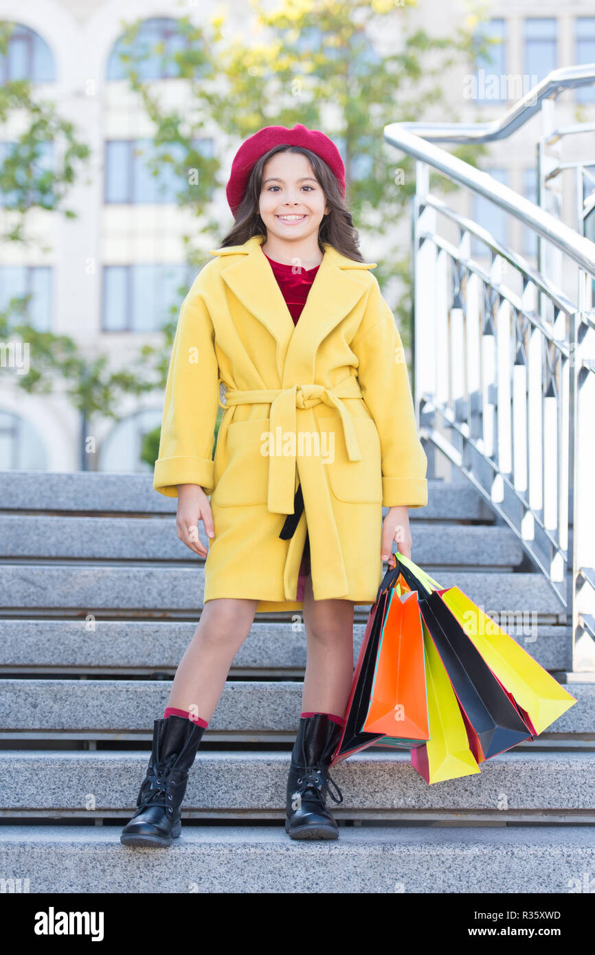 dcf74aacee Girl cute little lady dressed french style coat and beret carry shopping  bags. Autumn shopping