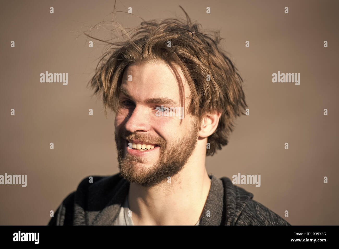 happy handsome man with smiling face or bearded guy with beard and
