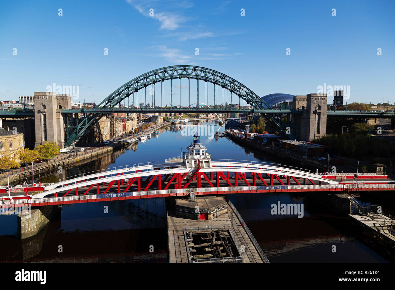 The Swing Bridge and Tyne Bridge spanning the River Tyne in north-east England. The bridges connect Newcastle upon Tyne and Gateshead. - Stock Image