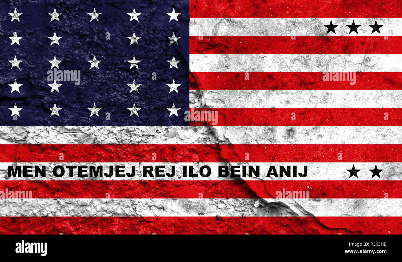 Flag of Bikini Atoll close up painted on a cracked wall, concept of armed actions and conflicts in the world - Stock Image