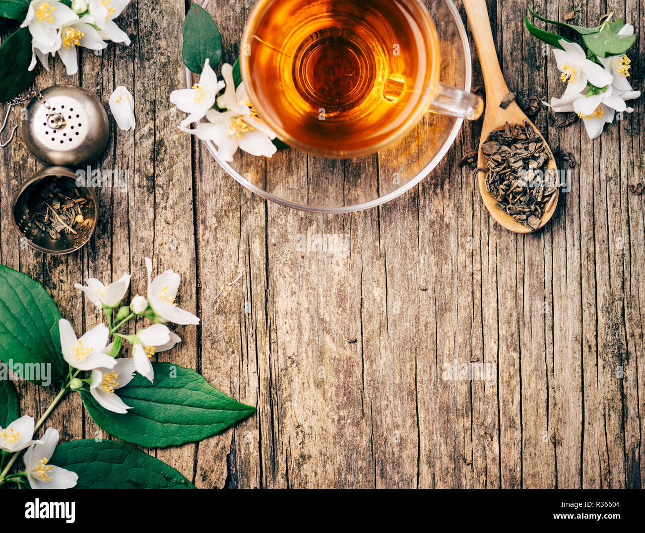 Top View Of Cup Of Asian Hot Green Tea And Jasmine Flower On Rustic