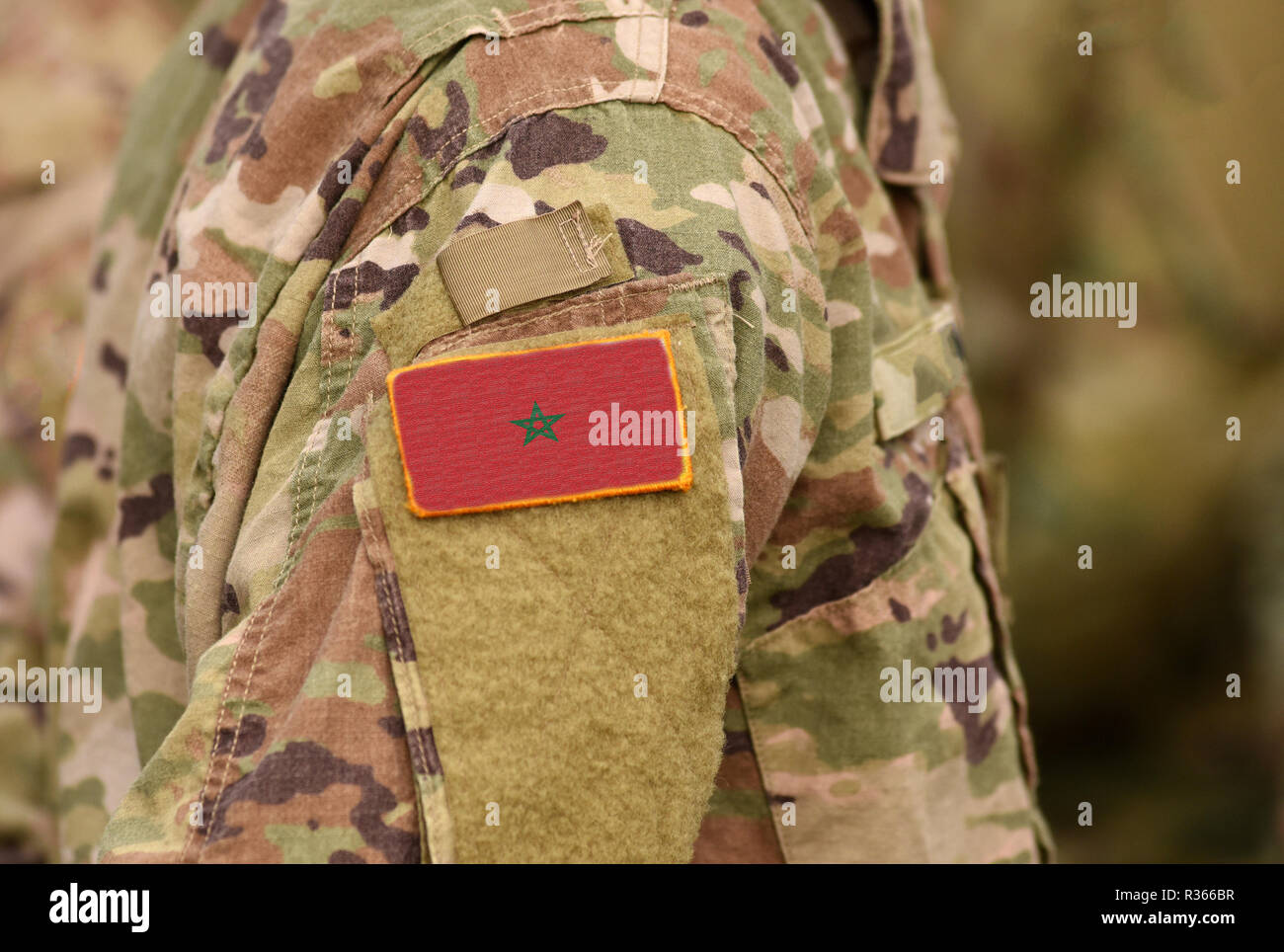 Morocco flag on soldiers arm. Morocco troops (collage) - Stock Image