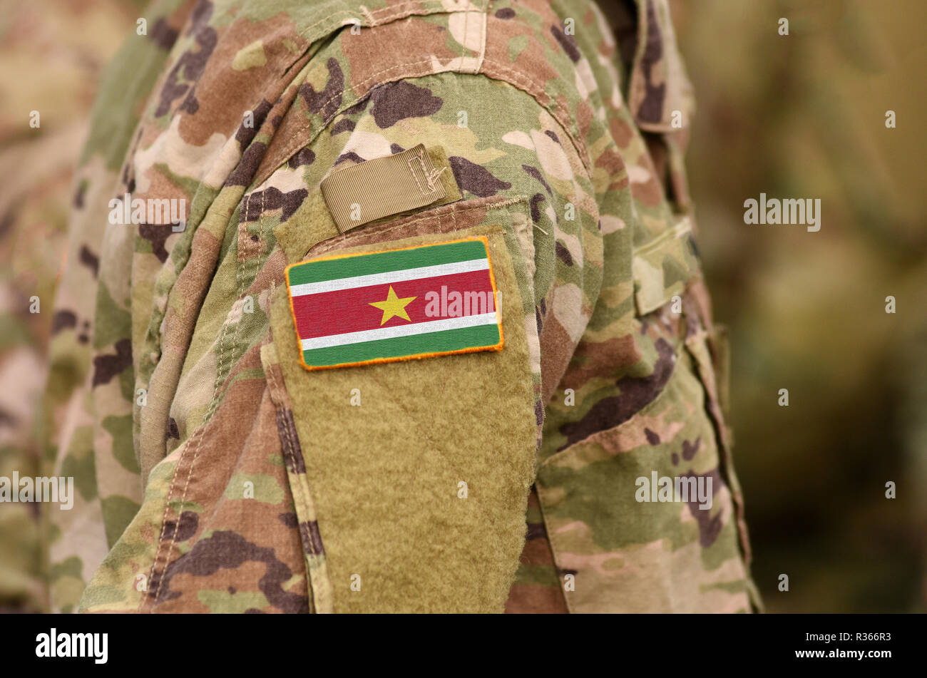 Suriname flag on soldiers arm. Suriname army (collage) - Stock Image