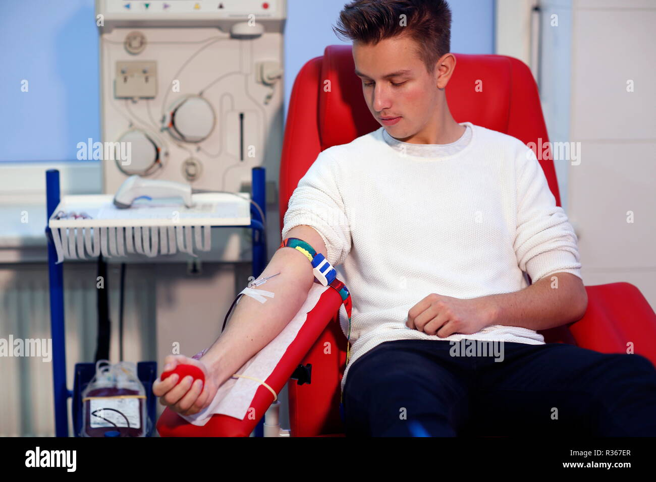 Patient taking blood at the transfusion ward of a hospital - Stock Image