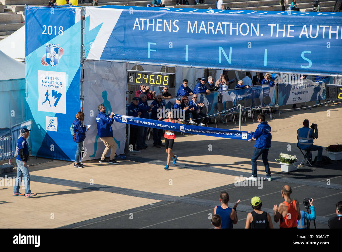 36th Athens Authentic Marathon. Eleutheria Petroulaki crossing 3rd from the women the finish line at Panathenaic stadium.1st Greek champion from women Stock Photo