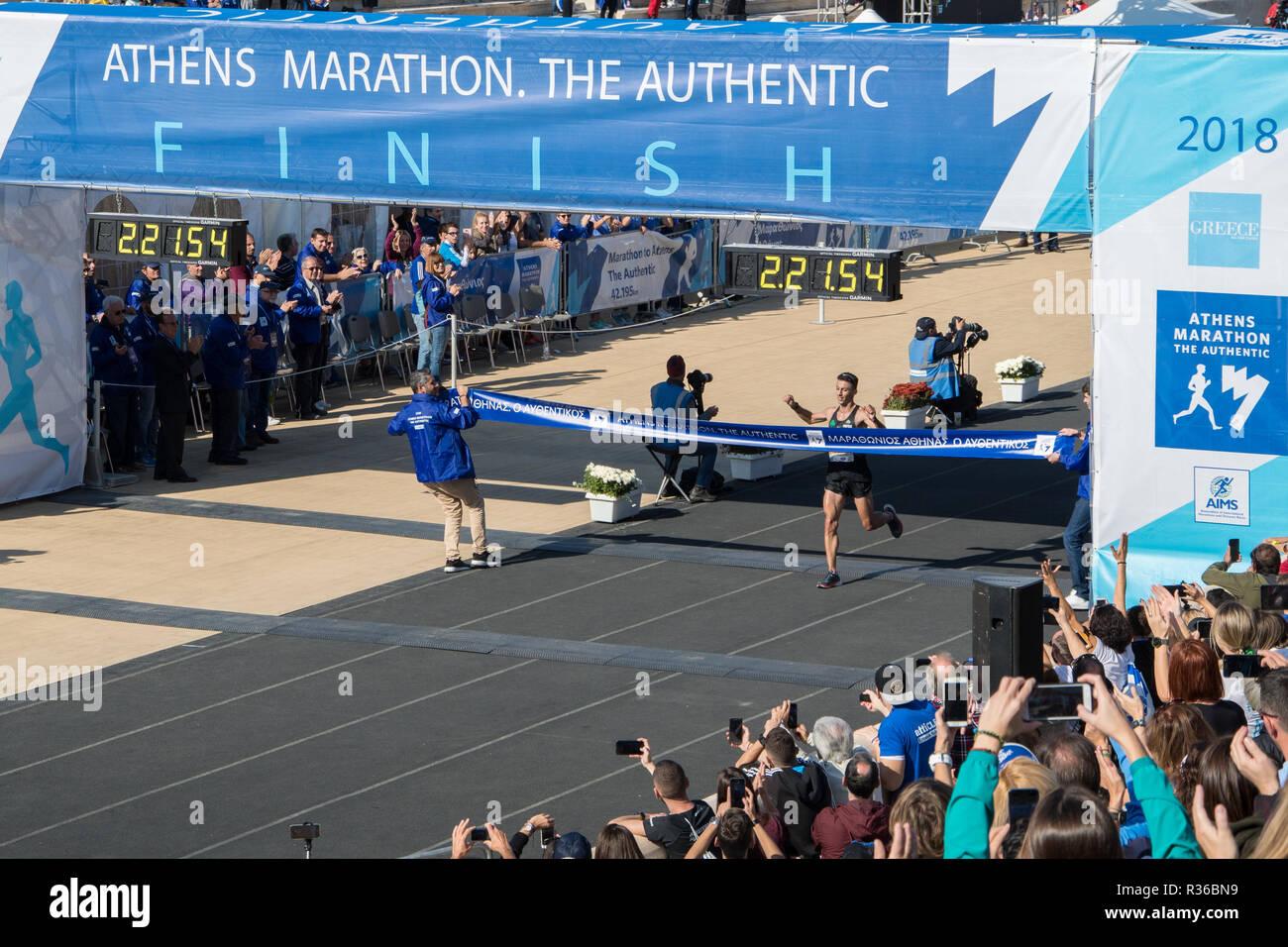 36th Athens Authentic Marathon. Konstantinos Gkelaouzos crossing 7th the finish line at Panathenaic stadium. 1st Greek champion. - Stock Image
