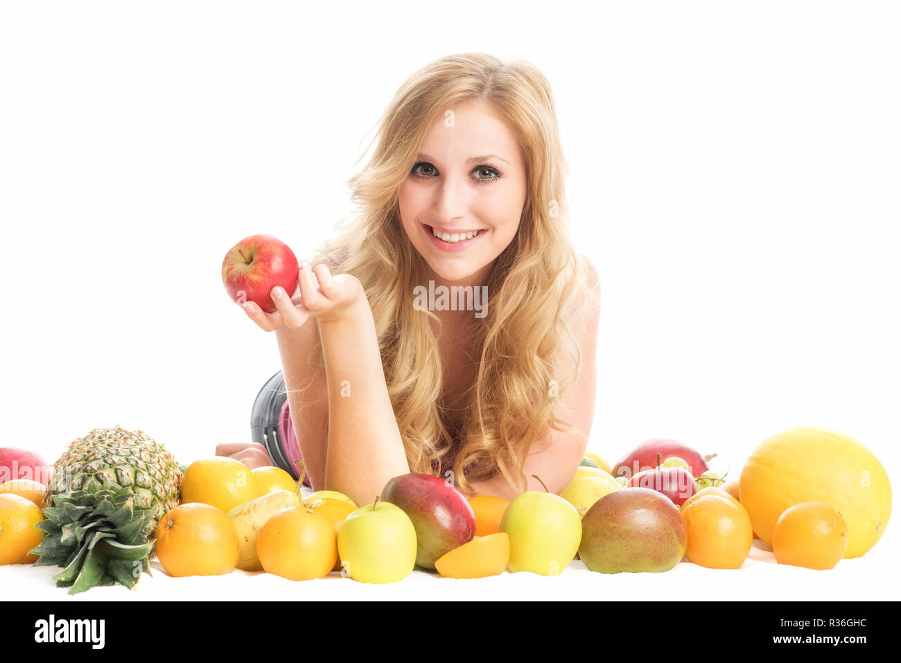 woman in the midst of fruit - Stock Image