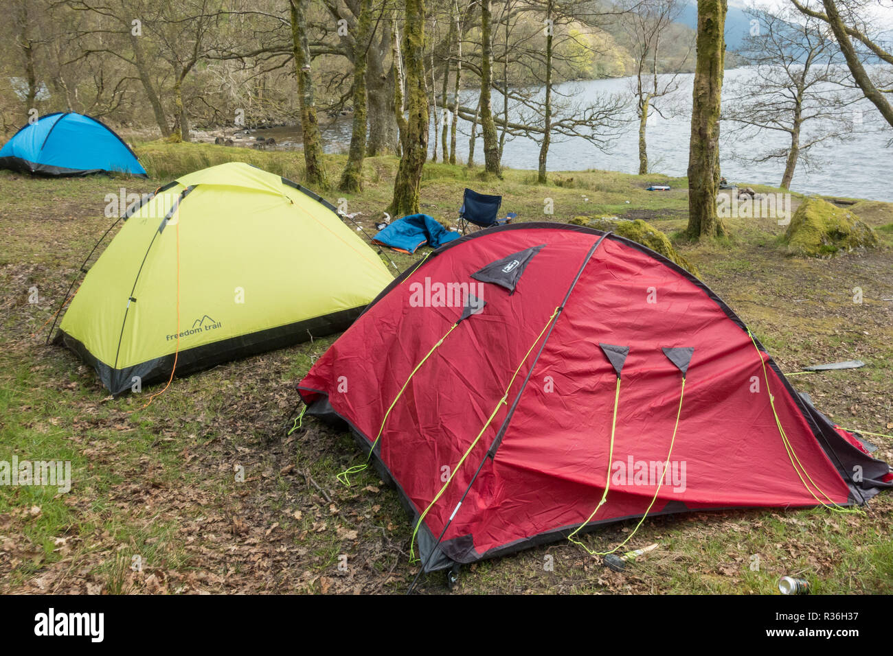 Loch Lomond litter - abandoned tents and camping equipment on the east shore north of Rowardennan just outside the camping management zone, Scotland - Stock Image