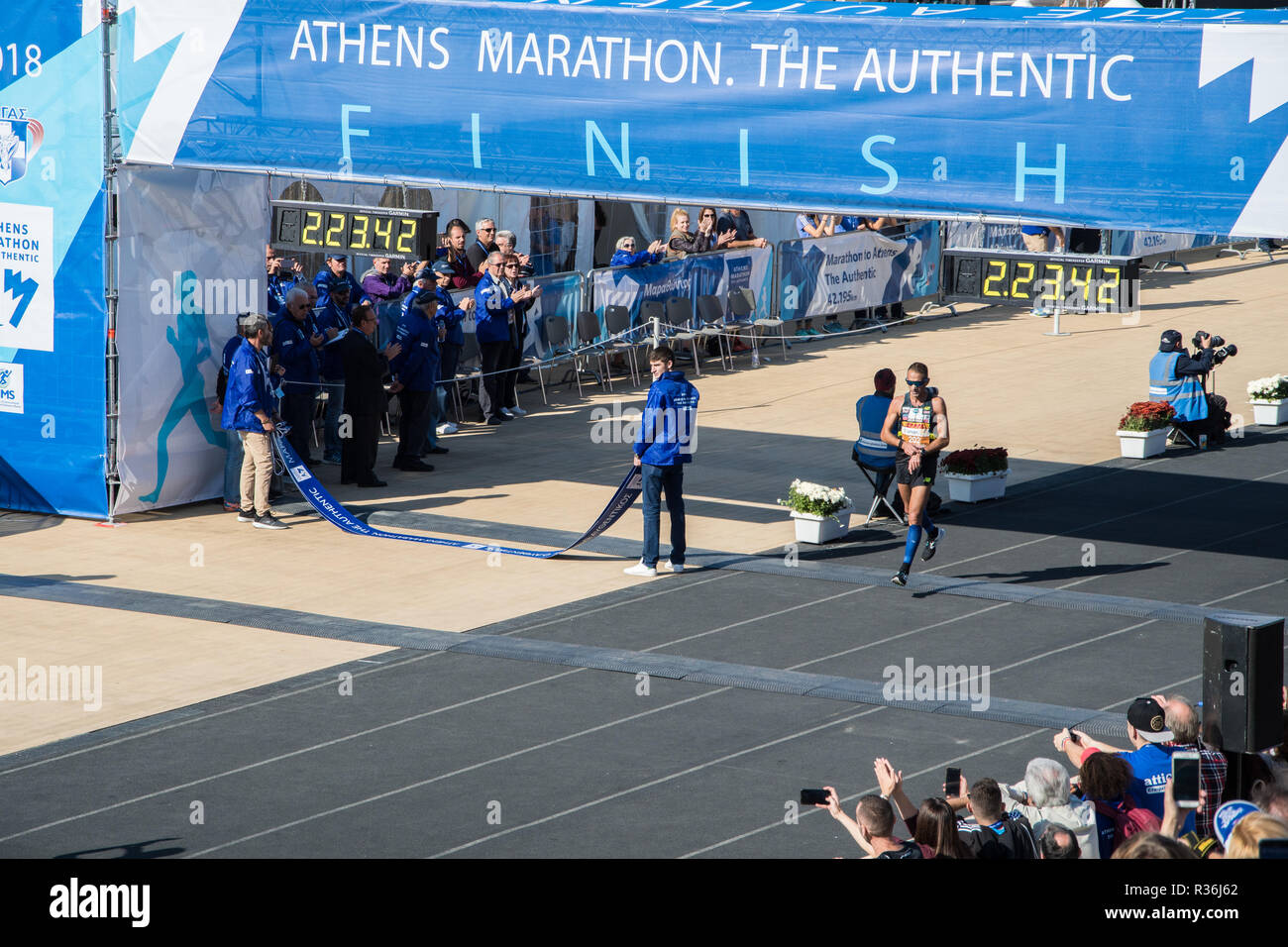 36th Athens Authentic Marathon. Christoforos Merousis crossing 2nd of the Panhellinic Championship at Panathenaic stadium Stock Photo