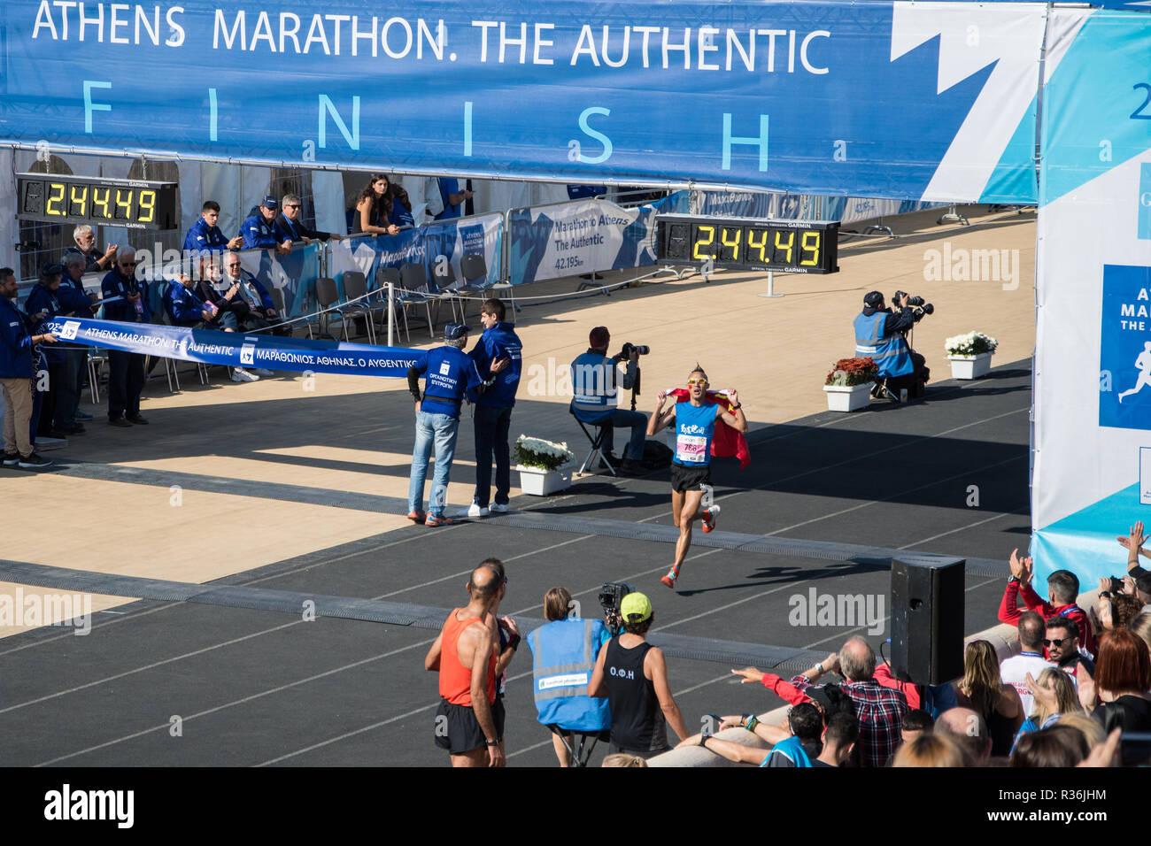 36th Athens Authentic Marathon. Ma Liang Wu from China crossing the finish line at Panathenaic stadium Stock Photo