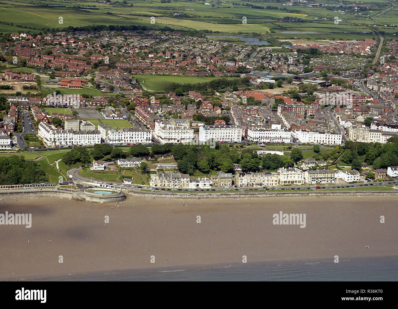 Aerial photo of seaside resort of Filey North Yorkshire showing upper and lower promenades and countryside behind the town - Stock Image