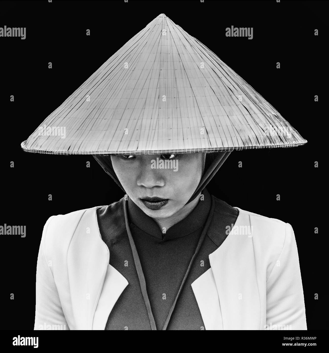 Black and white portrait of smart young Vietnamese lady in traditional conical  hat. 86194b26e65