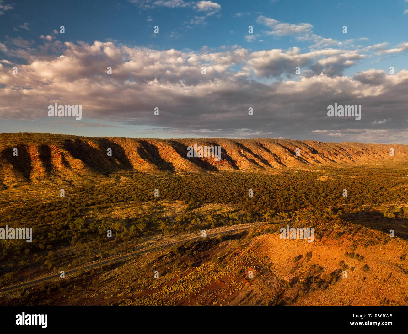 Aerial shot of the MacDonnell Ranges with the famous Namatijira Drive. - Stock Image