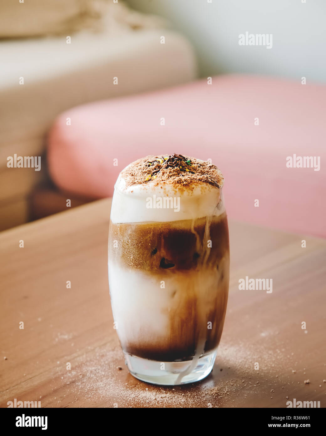 Ice Caffe Mocha with Whipped Cream on Wooden Table on Hot Summer Sunny Day - Stock Image