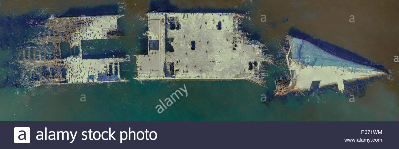 Aerial: Cement Ship Beached on the Coast in California - Stock Image