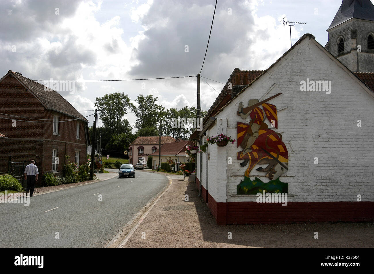 A painted mural illustrating the Battle of the Hundred Years War in the village of Azincourt, in the commune of the Pas-de-Calais department in northe - Stock Image