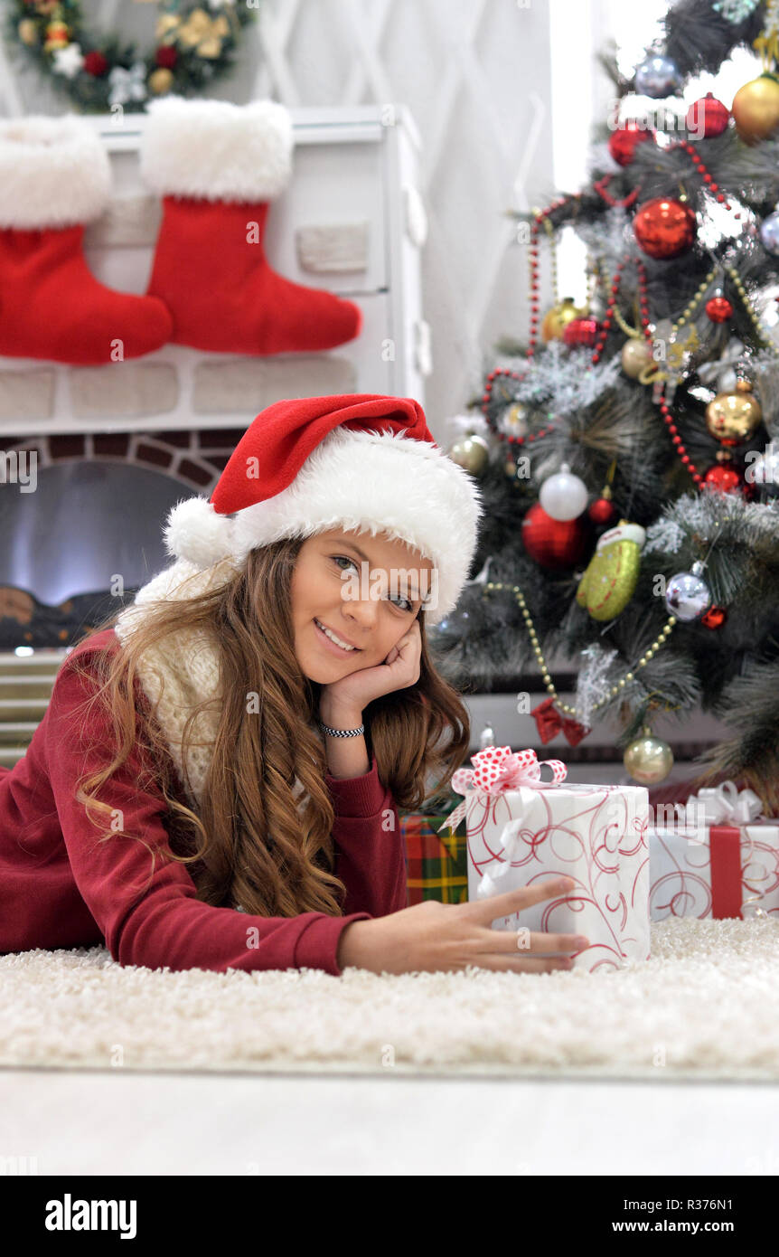 Cute Christmas Gifts For Teenage Girls.Happy Cute Teenage Girl With Christmas Present Stock Photo