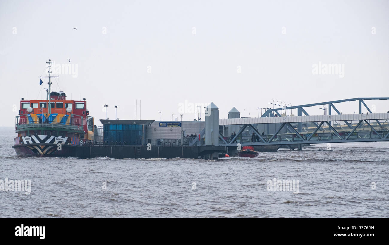 LIVERPOOL, ENGLAND - NOVEMBER 5, 2018: The river Mersey passenger ferry 'Snowdrop' docked at the Liverpool landing stage prior to crossing to Wallasey - Stock Image