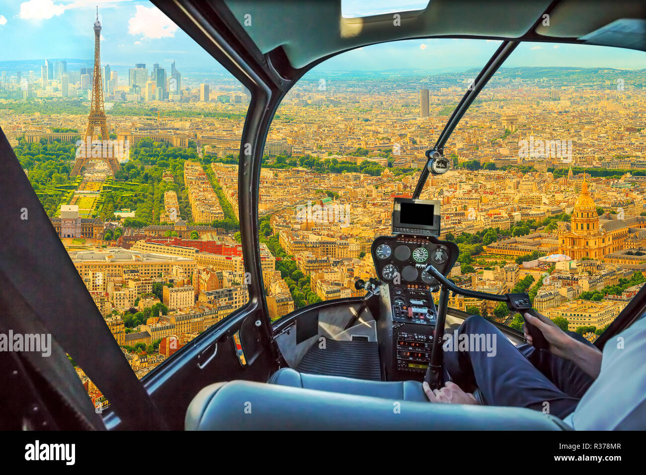 Helicopter cockpit flying on Panorama of Tour Eiffel and national residence of the Invalids in Paris, French capital, Europe. Scenic flight above Paris skyline and cityscape background. Stock Photo