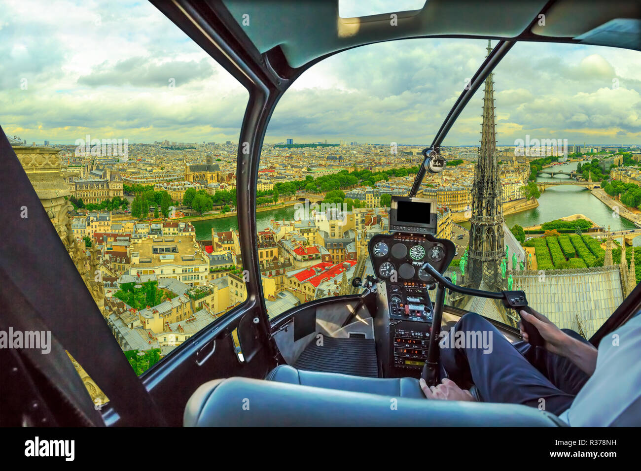 Helicopter cockpit flying on Pont Saint-Michel bridge on Senna river of Paris, French capital, Europe. Scenic flight above Paris skyline. Stock Photo