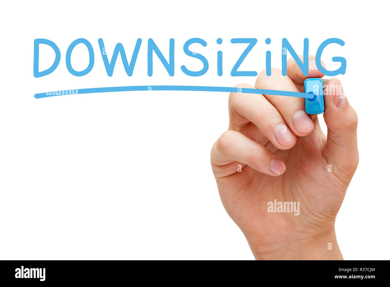 Hand writing the word Downsizing with blue marker on transparent glass board isolated on white. - Stock Image