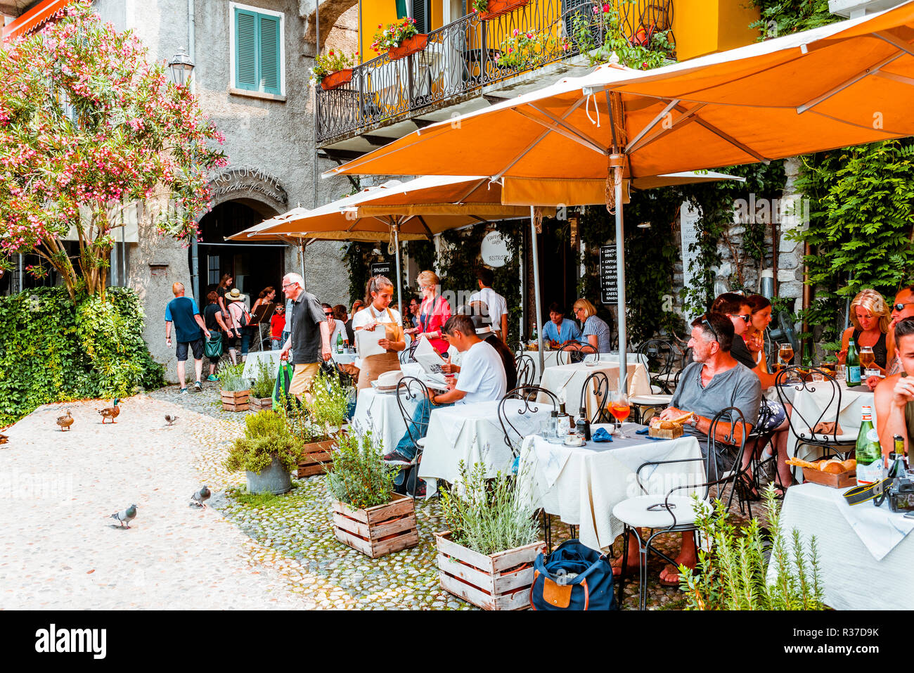 Varenna Caffe, Bistrot. Outdoor restaurant terrace. Varenna, Province of Lecco, Lombardy, Italy, Europe - Stock Image