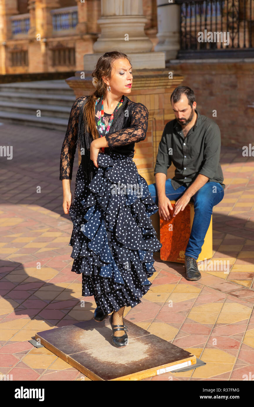 Seville, Spain - November 13, 2018: Flamenco dancer and other unidentified people at the Plaza de Espana. Seville is considered a birthplace of flamen - Stock Image