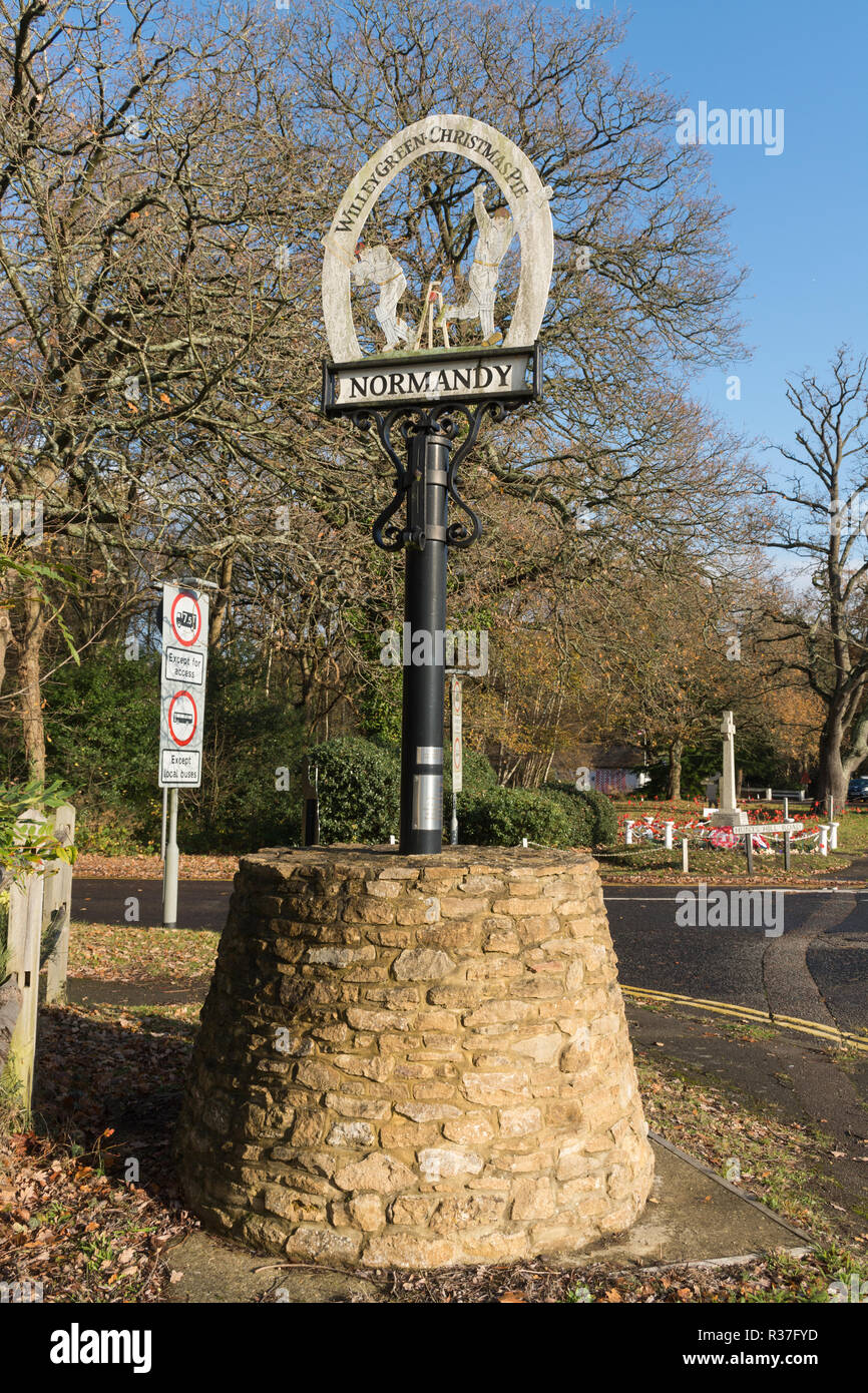 Village sign in the village of Normandy in Surrey, UK, also representing the small settlements of Willey Green and Christmas Pie - Stock Image