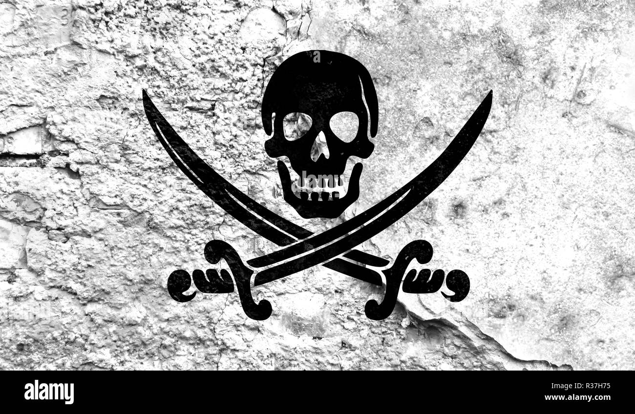 Flag of Pirates white close up painted on a cracked wall, concept of armed actions and conflicts in the world - Stock Image